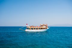 Yacht with tourists sailing on the sea, rest for all family, cruise on the islands royalty free stock images