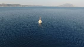 Traditional Yacht is Traveling Slowly. A yacht with traditional design is traveling slowly in the calm sea stock video