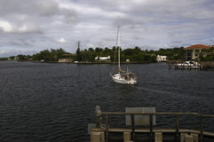 Yacht travels intracoastal waterway in Florida Stock Photo