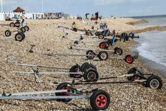 Yacht trollies arrayed on Bexhill-on-Sea beach in East Sussex, England. Bexhill Sailing Club has regular regattas thus producing this unusual image when the Royalty Free Stock Photography