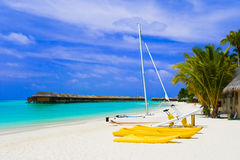 Yacht on tropical beach. Travel vacation background Stock Photo