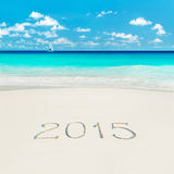 Yacht at tropical beach and 2015 happy new year sandy caption. S Royalty Free Stock Photography