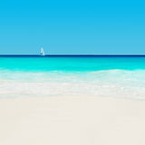 Yacht at tropical sandy beach. Anse Georgette, Praslin island, S. Eychelles - vacation background Stock Photography