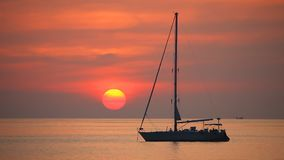 Tropical sea at beautiful sunset. Yacht in the tropical sea at sunset. Travel background stock footage
