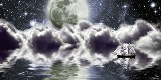 Yacht under moon. Ship in a fantastic location in the moonlight Stock Photo