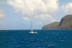 A yacht under sail in the bequia channel Royalty Free Stock Photo