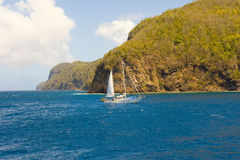 A yacht under sail in the bequia channel Royalty Free Stock Photography