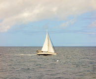 A yacht under sail in the bequia channel Royalty Free Stock Image