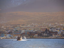 Yacht in the Ushuaia bay. View of the coastline at afternoon, Argentina. April 2103 Royalty Free Stock Photography