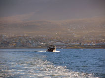 Yacht in the Ushuaia bay. View of the coastline at afternoon, Argentina. April 2103 Royalty Free Stock Photos