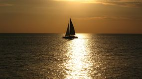 Yacht at sunset on the sea Stock Photos