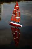 Yacht on the water. Model of a small boat launch from the pier on the lake royalty free stock photography