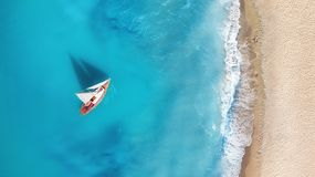 Yacht on the water surface from top view. Turquoise water background from top view. Summer seascape from air. Travel concept and idea stock images