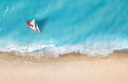Yacht on the water surface from top view. Turquoise water background from top view. Summer seascape from air. Travel concept and idea stock photos