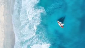 Yacht on the water surface from top view. Turquoise water background from top view. Summer seascape from air. Travel concept and idea royalty free stock photos