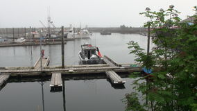 Yacht wharf on calm water of Pacific Ocean on background coast in Sitka. stock video footage