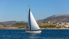 Yacht with white sail glides on the sea surface. Travel. Stock Image