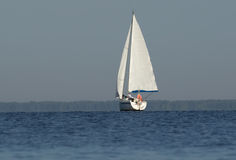 Yacht with white sails rear view Royalty Free Stock Photos