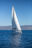 Yacht with white sails in the sea. Royalty Free Stock Photo