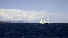 Yacht on a wild sea. Classic sailing yacht on a wide expanse of sea in a gale Stock Images