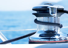 Yacht Winch. Sailboat Winch and Rope Yacht detail. Yachting royalty free stock images