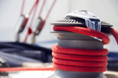 Yacht winch. With the red rope royalty free stock images