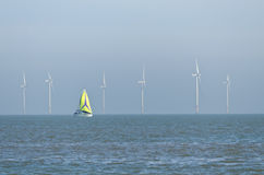 Yacht and wind farm Royalty Free Stock Photo