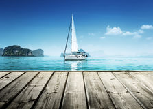 Yacht and wooden platform Stock Photography
