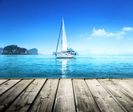 Yacht and wooden platform. And sky blue Stock Image