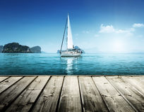 Yacht and wooden platform stock images