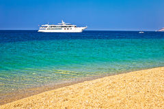Yacht on Zlatni Rat paradise beach. Pebble and turquoise sea view, Bol, Brac island, Croatia Stock Photography