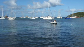 Yachters arriving at a jetty in the windward islands stock footage