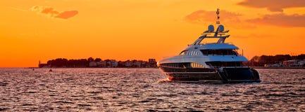 Yachtig on open sea at golden sunset panoramic view. Zadar, Dalmatia, Croatia Royalty Free Stock Images