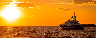 Yachtig on open sea at golden sunset panoramic view. Zadar, Dalmatia, Croatia Stock Photography