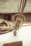 Yachting. Block with rope. Detail of a sailing boat. Yachting. Sailboat view of different parts of yacht, block with rope. Detail of a sailing boat Stock Photo