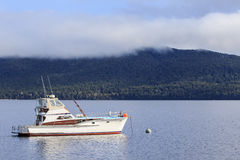 Yachting boat in te anau lake fiord land national park new zeala Royalty Free Stock Photography