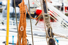 Yachting, coiled rope on deck of sailboat, details of yacht. Yachting, coiled rope on deck of sailboat, details and part of yacht Stock Images