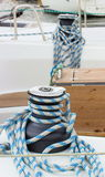 Yachting, coiled rope on sailboat, details of yacht. Yachting, coiled rope and bollard on sailboat, details and part of yacht Royalty Free Stock Photography