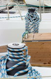 Yachting, coiled rope on sailboat, details of yacht. Yachting, coiled rope and bollard on sailboat, details and part of yacht Stock Photo