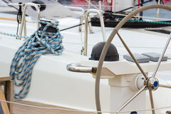 Yachting, coiled rope on sailboat, details of yacht Royalty Free Stock Photo