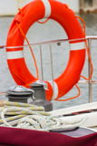 Yachting, colorful rope with orange lifebuoy on sailboat Stock Photography