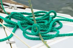 Yachting, green rope on deck of sailboat, details of yacht Stock Photos