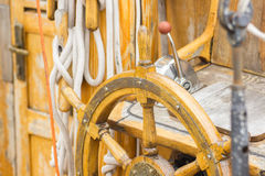 Yachting, helm of old wooden sailboat in port of sailing Royalty Free Stock Photos