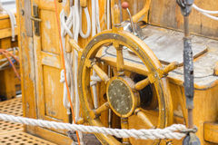 Yachting, helm of old wooden sailboat in port of sailing Royalty Free Stock Photography
