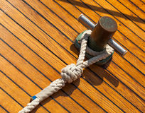Yachting hitch. On the background of a wooden deck Royalty Free Stock Photo
