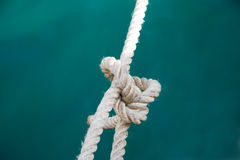 Yachting hitch. Marine knot on a background a blue sea Royalty Free Stock Photo
