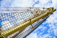 Yachting. Mast of sailboat against blue sky. Royalty Free Stock Images