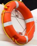 Yachting, orange lifebuoy on sailboat, safety travel Royalty Free Stock Images