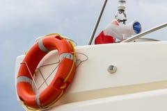 Yachting, orange lifebuoy on sailboat, safety travel Royalty Free Stock Photo