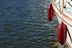 Yachting. parts of yacht maritime red fenders Stock Photos
